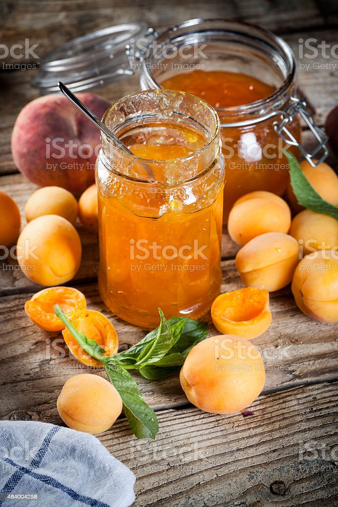 Jam apricot peaches mint leaves stock photo