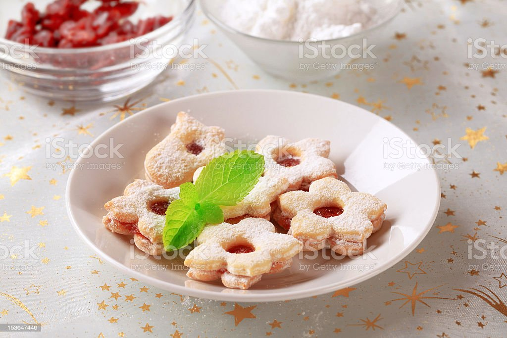 Jam filled cookies sprinkled with icing sugar royalty-free stock photo