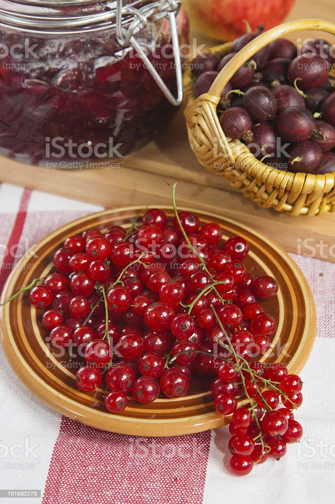 Jam with berries of red currant and gooseberry royalty-free stock photo