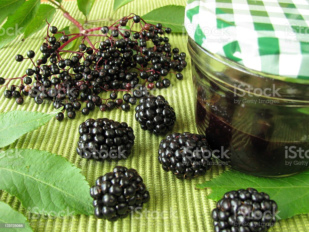 Jam with elderberries and blackberries stock photo