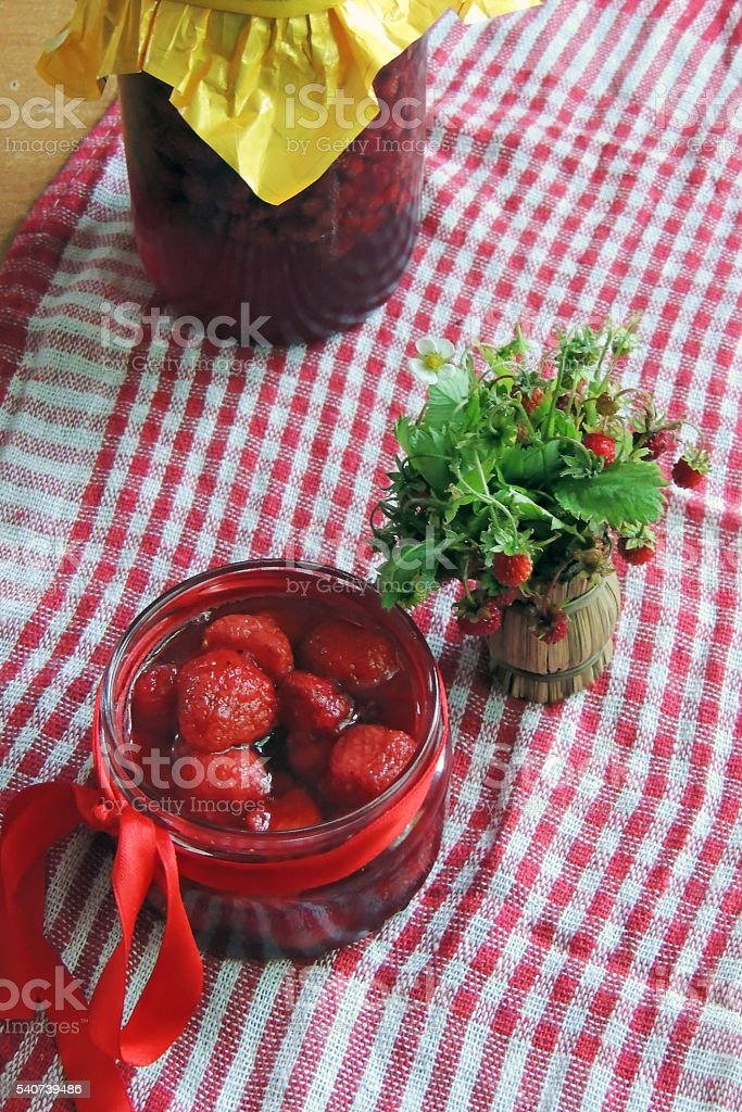 Jam with strawberries stock photo