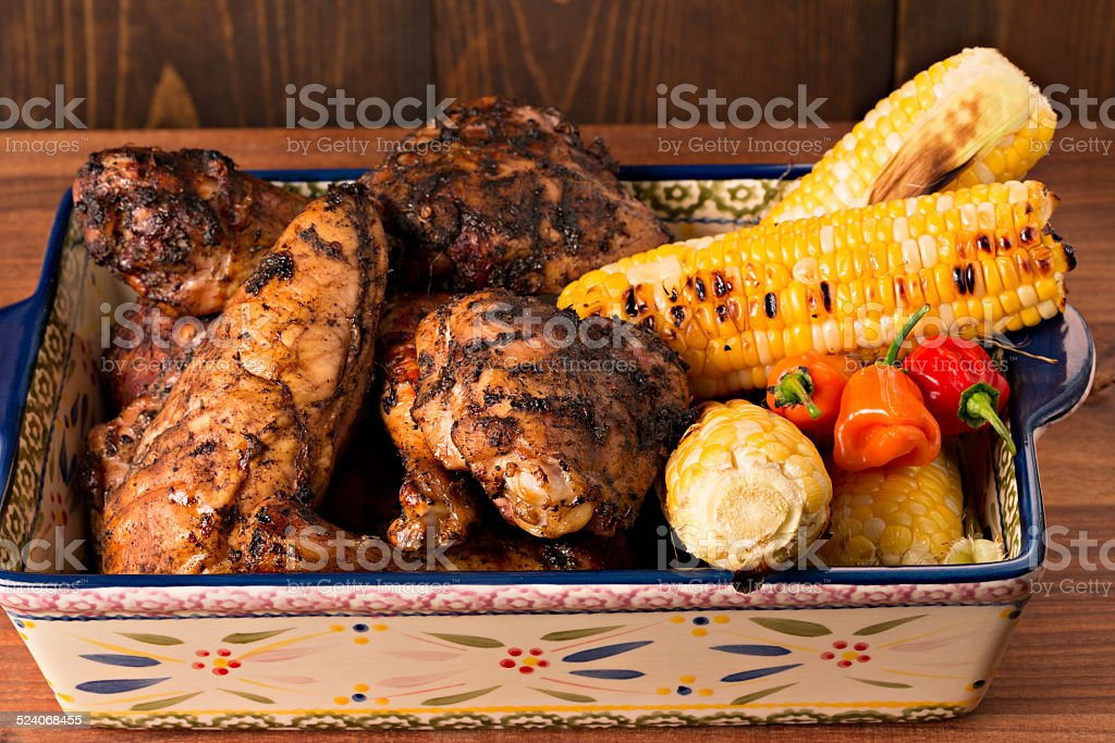 Jamaican Jerk Chicken And Grilled Corn stock photo