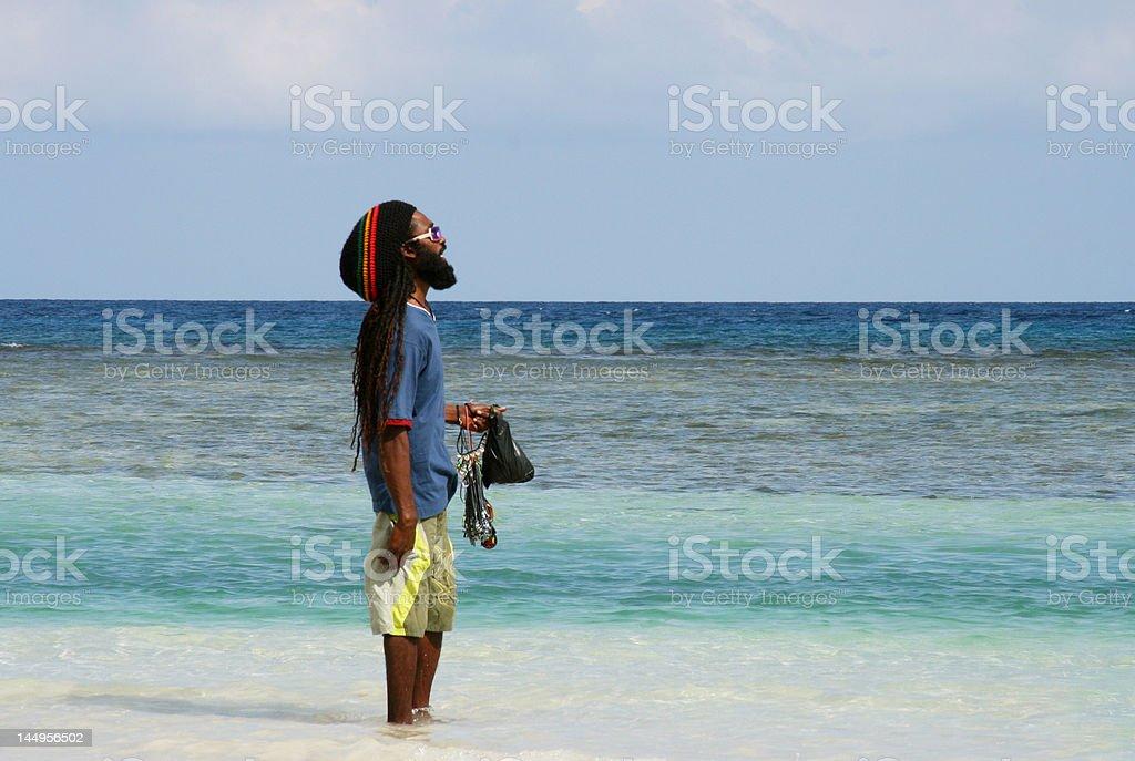 Jamaican man overlooking the sea stock photo