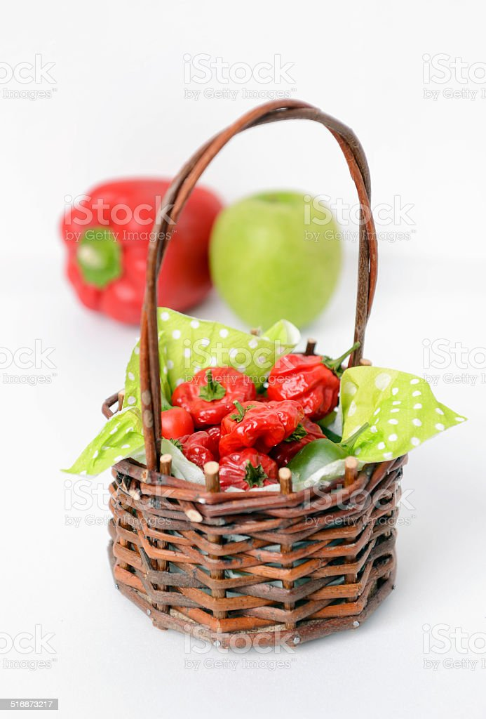 Jamaican red hot peppers in a basket stock photo