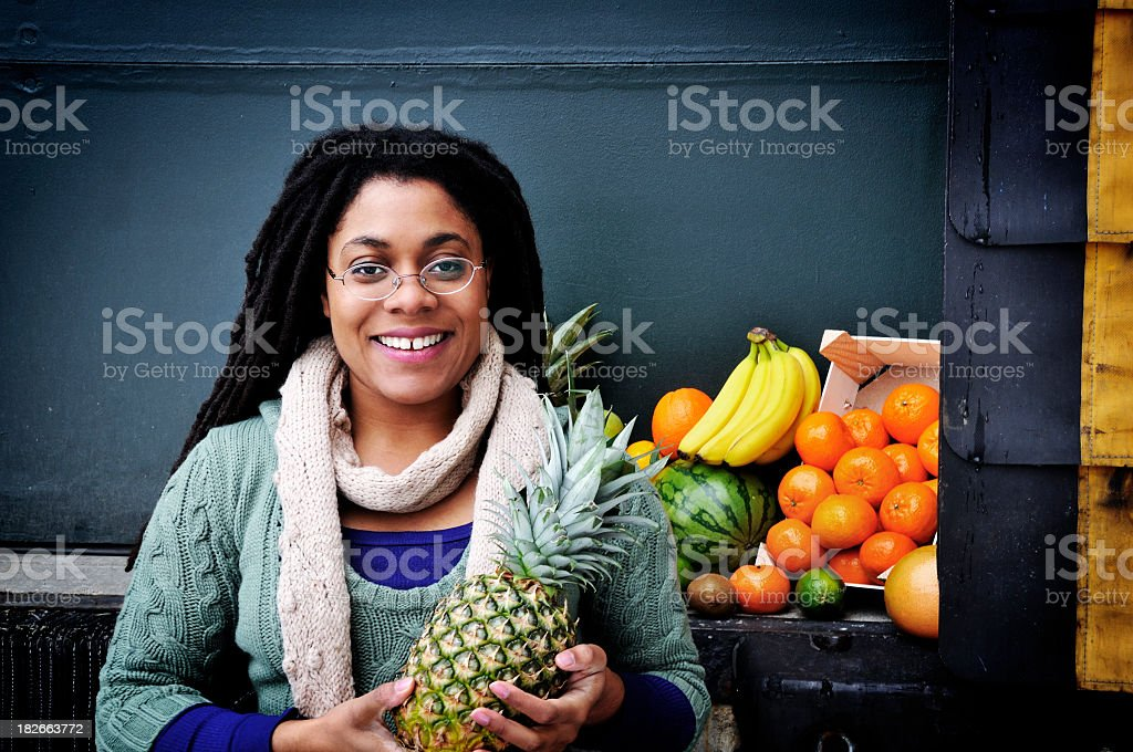 Jamaican Woman, Fruit, and Loading Dock stock photo