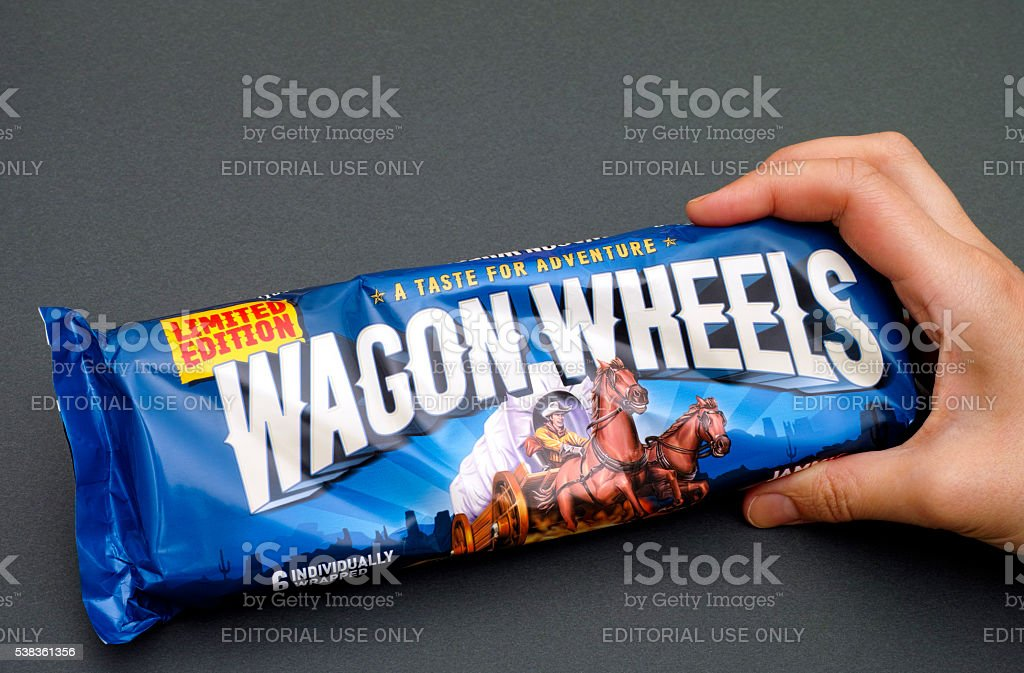 Jammie Wagon Wheels pack in woman hand stock photo