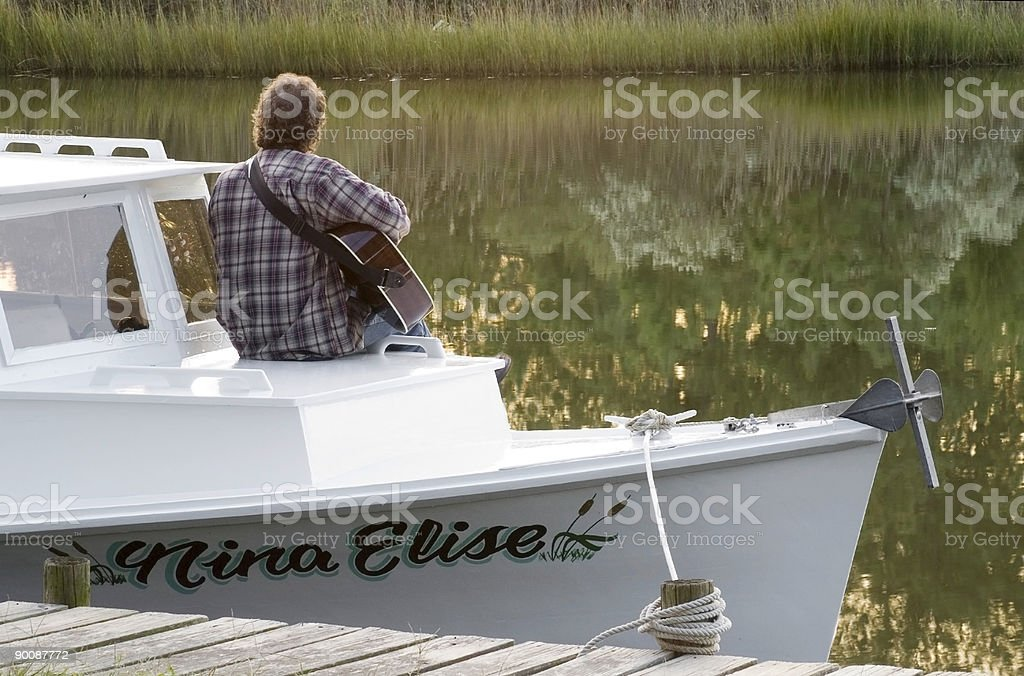 Jamming at Sunset on the Boat royalty-free stock photo