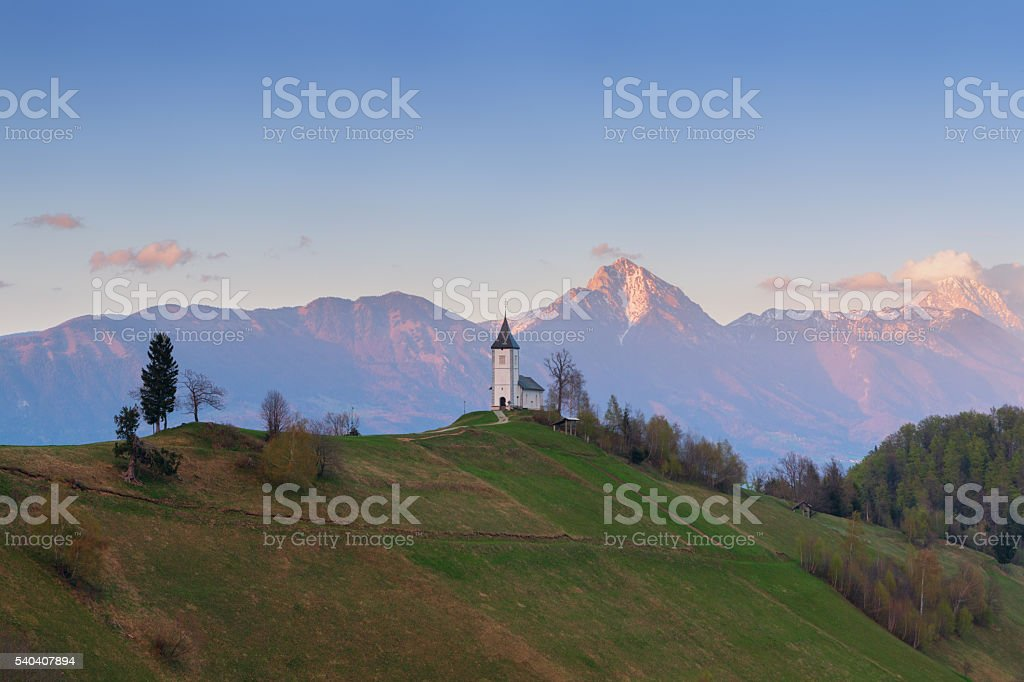Jamnik church on a hillside at sunset stock photo