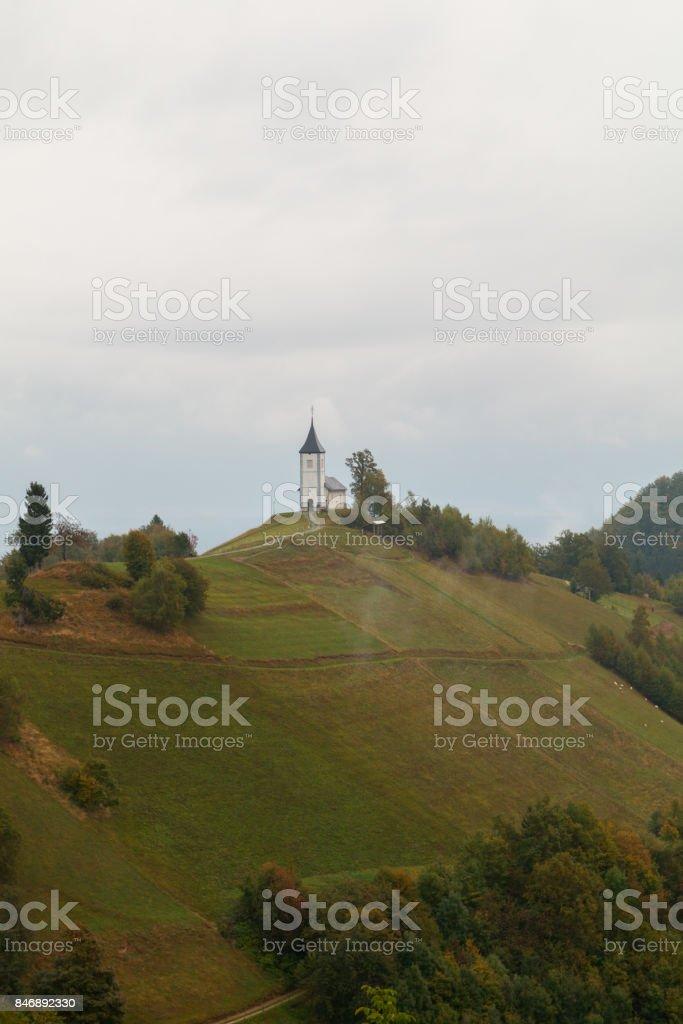 Jamnik church on a hillside in autumn at sunset stock photo