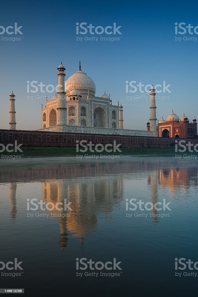 Jamuna River View of Taj Mahal and Reflection at Sunrise stock photo