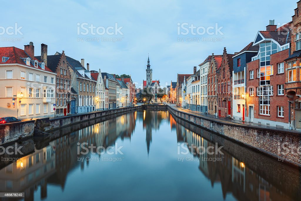 Jan van Eyck Square over the waters of Spiegelrei, Bruges stock photo