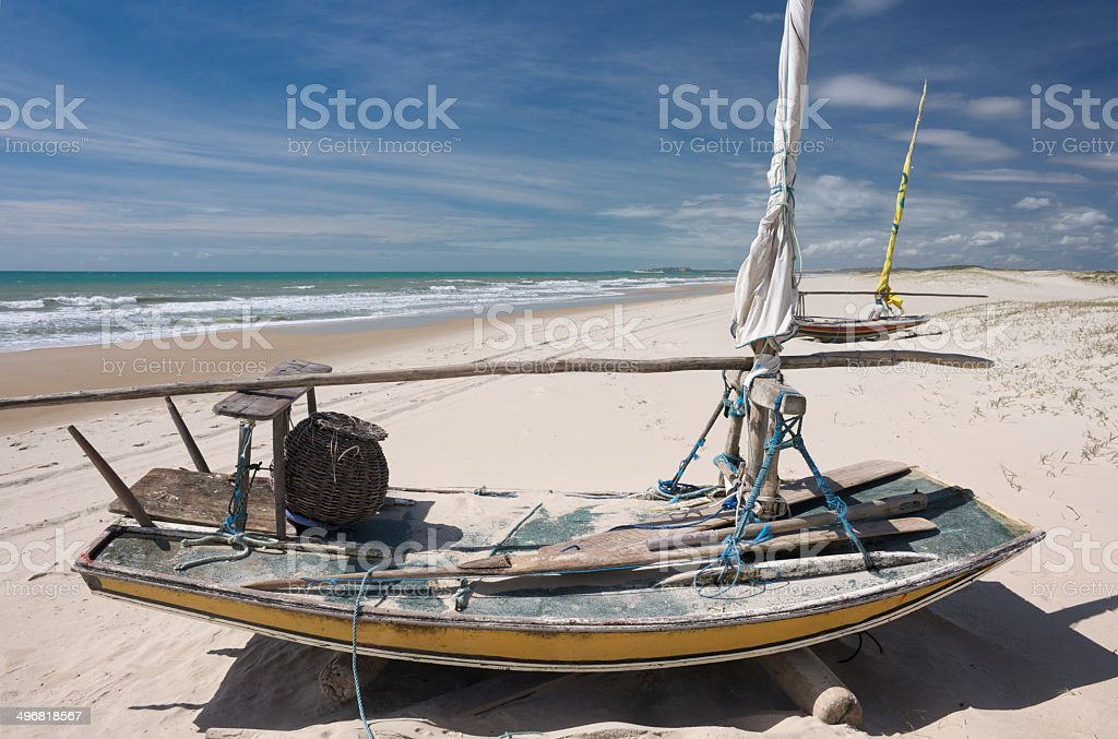 Jangada sailing boats lying on the endless tropical sandy beach stock photo