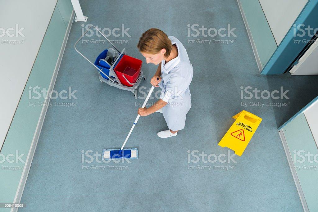 Janitor Cleaning Floor Of Corridor Pass stock photo
