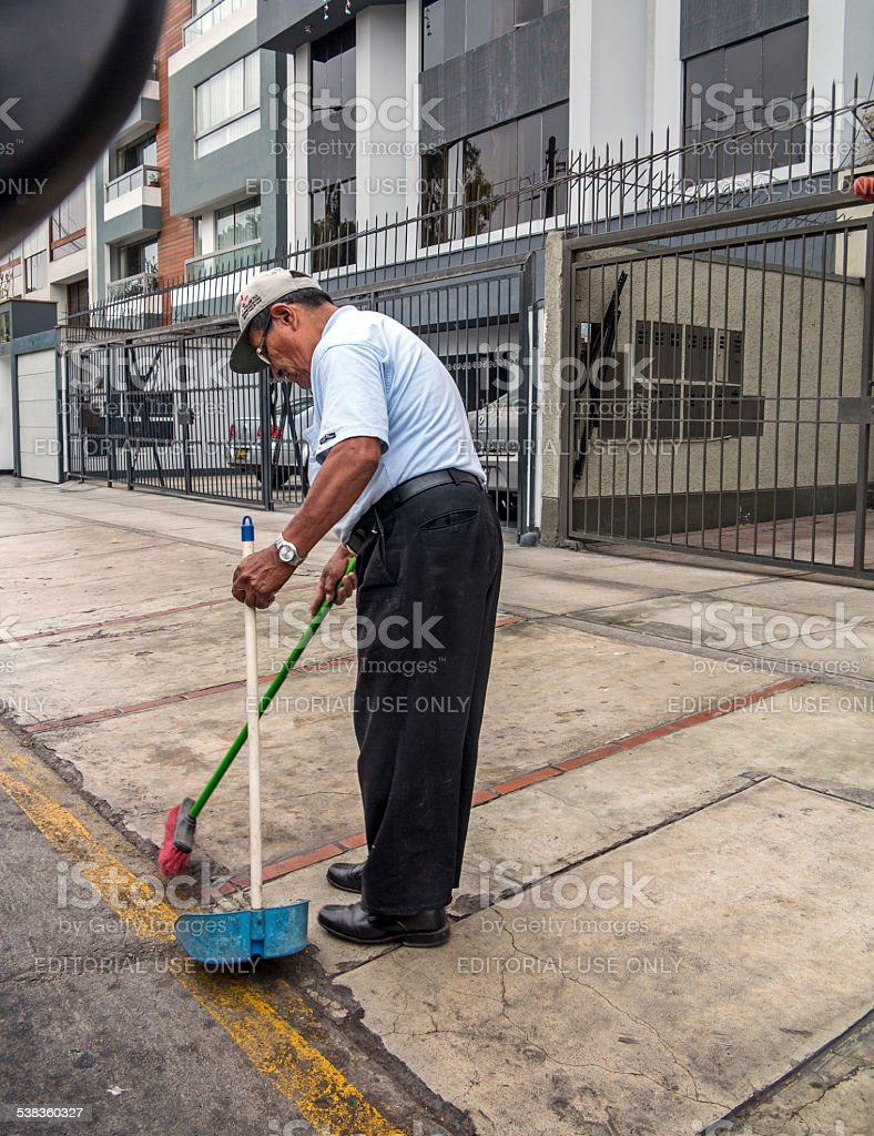 Janitor cleaning in street stock photo