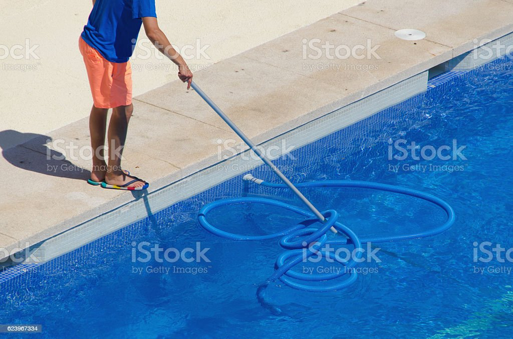 janitor cleaning the swimming pool stock photo