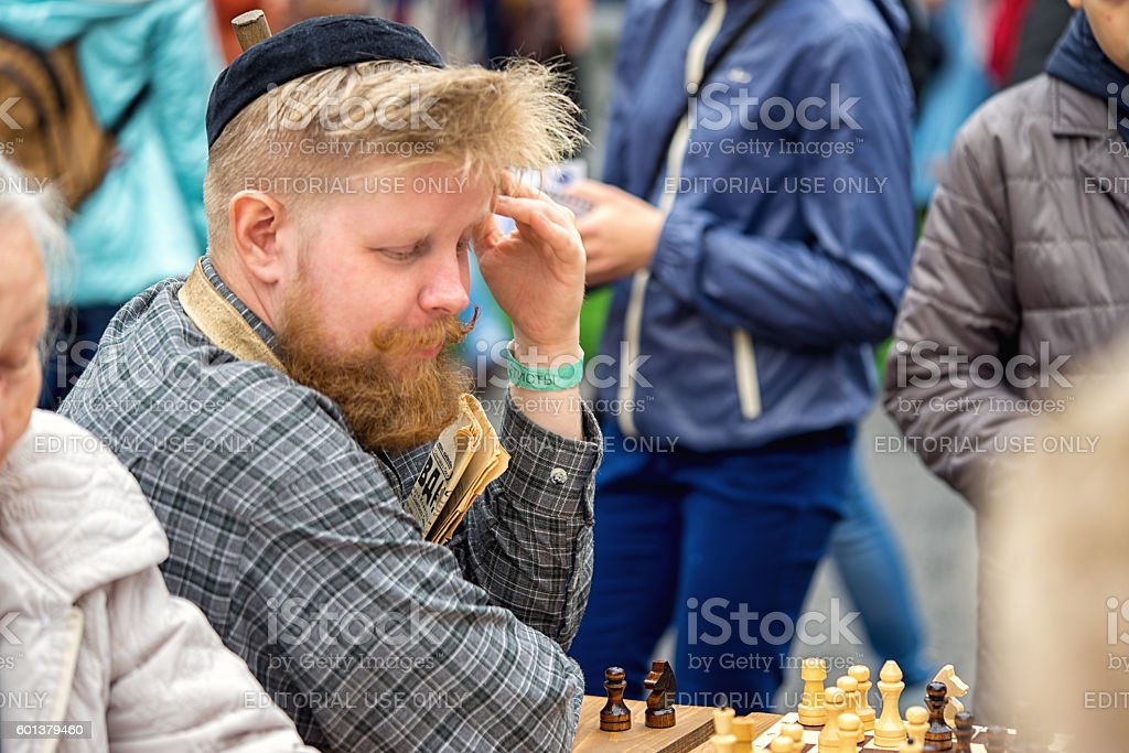 janitor laying in the courtyard of chess stock photo