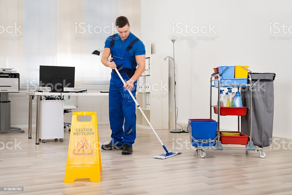 Janitor Mopping Floor In Office stock photo