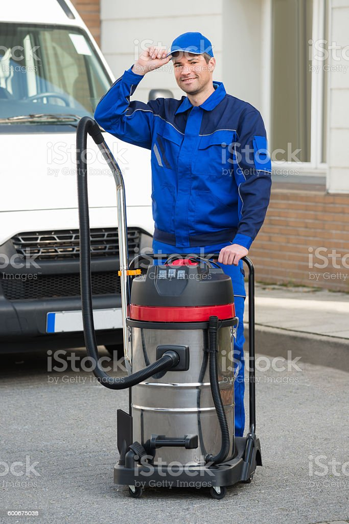 Janitor Wearing Cap While Standing On Street stock photo