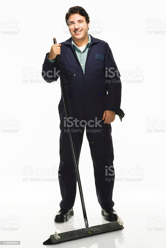 Janitor with broom on white background, portrait stock photo