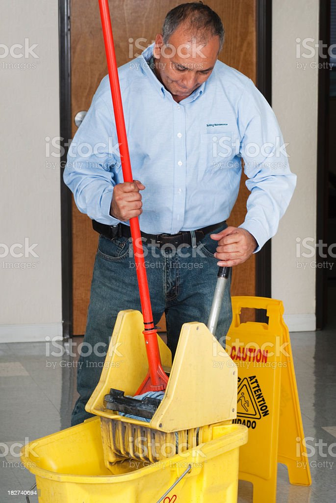 Janitorial Service Maintenance Man Cleaning Office Floor stock photo