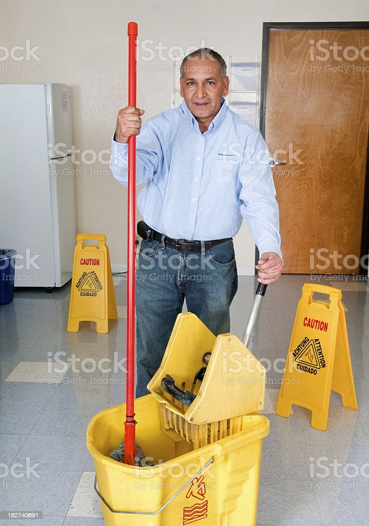 Janitorial Services - Maintenance Man Cleaning Office Floor royalty-free stock photo