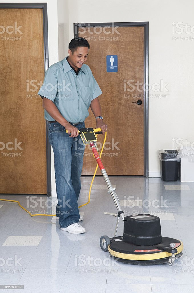 Janitorial Services Maintenance Man Cleaning Office Floor stock photo
