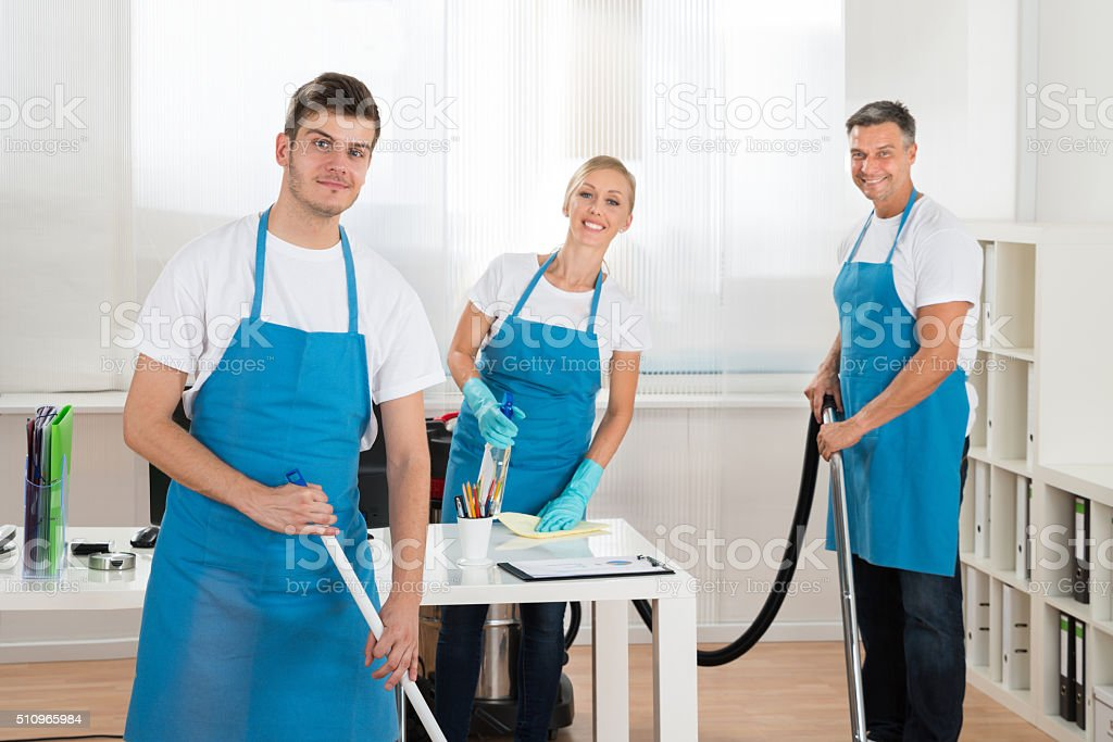 Janitors Cleaning Office stock photo