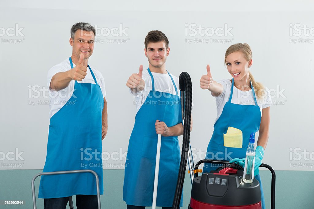 Janitors Showing Thumb Up Sign stock photo