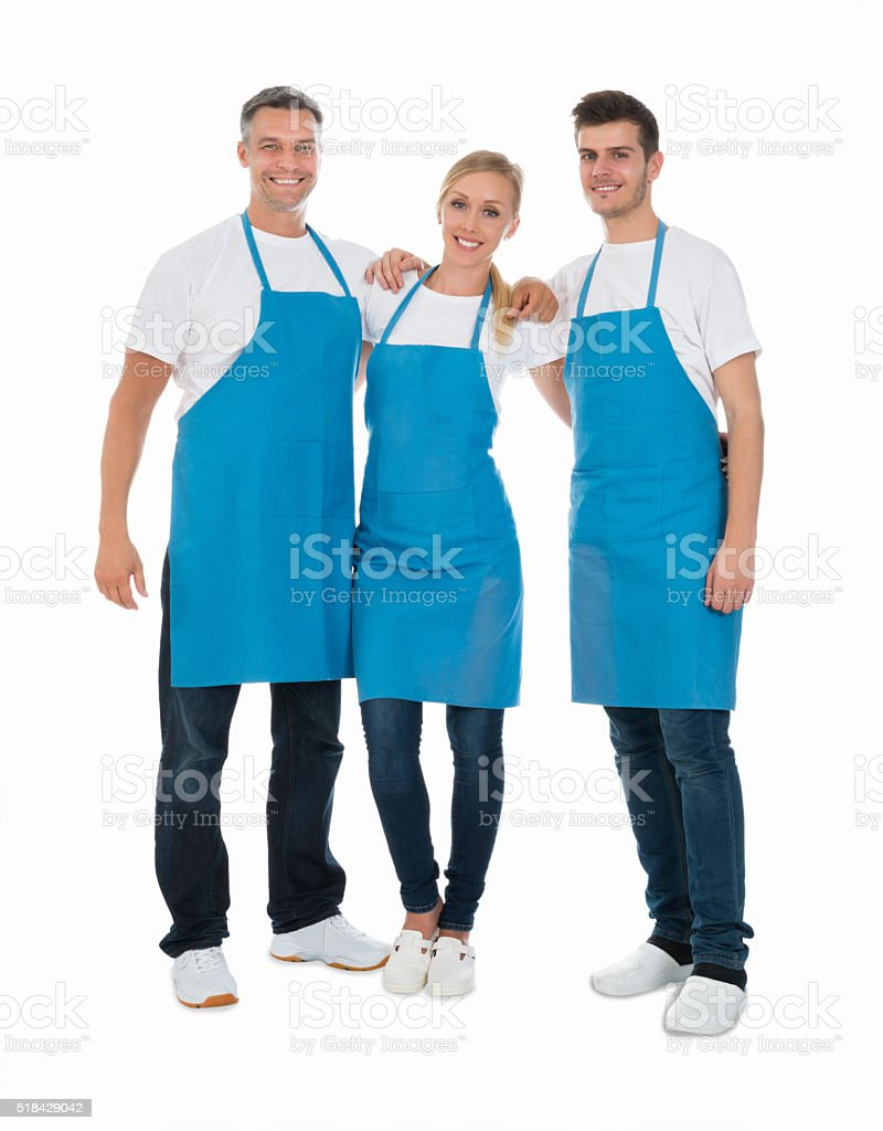 Janitors Wearing Blue Apron stock photo