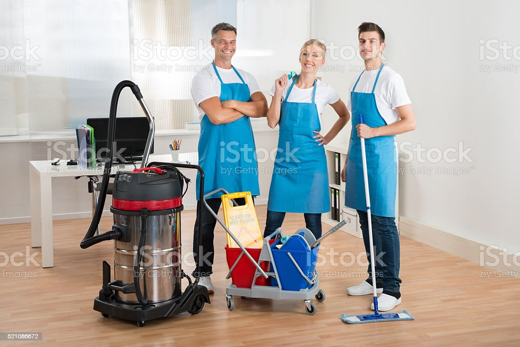 Janitors With Vacuum Cleaner And Cleaning Equipments stock photo