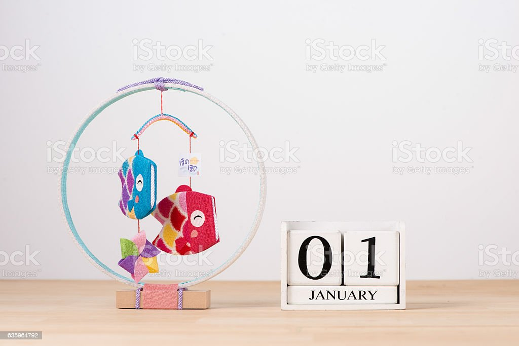 January 01 cube calendar on wooden table with empty space stock photo