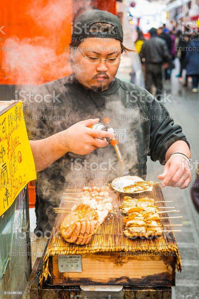 Japan chef cooking seafood street market food stall Osaka Japan stock photo
