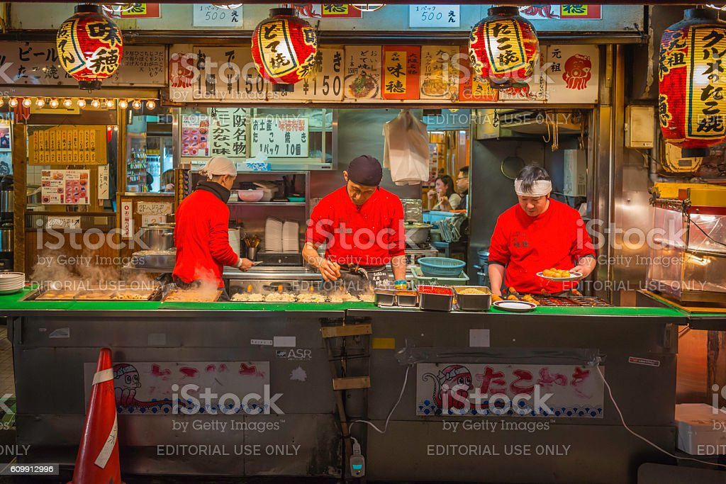 Japan city nightlife cooks serving traditional fast food Osaka stock photo