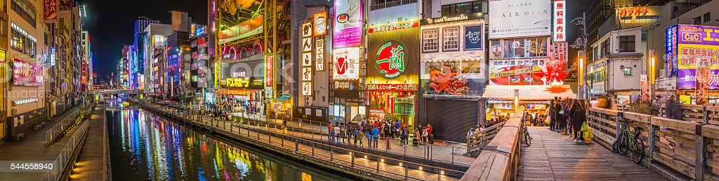 Japan city nightlife neon lights crowds of shoppers Dotonbori Osaka stock photo