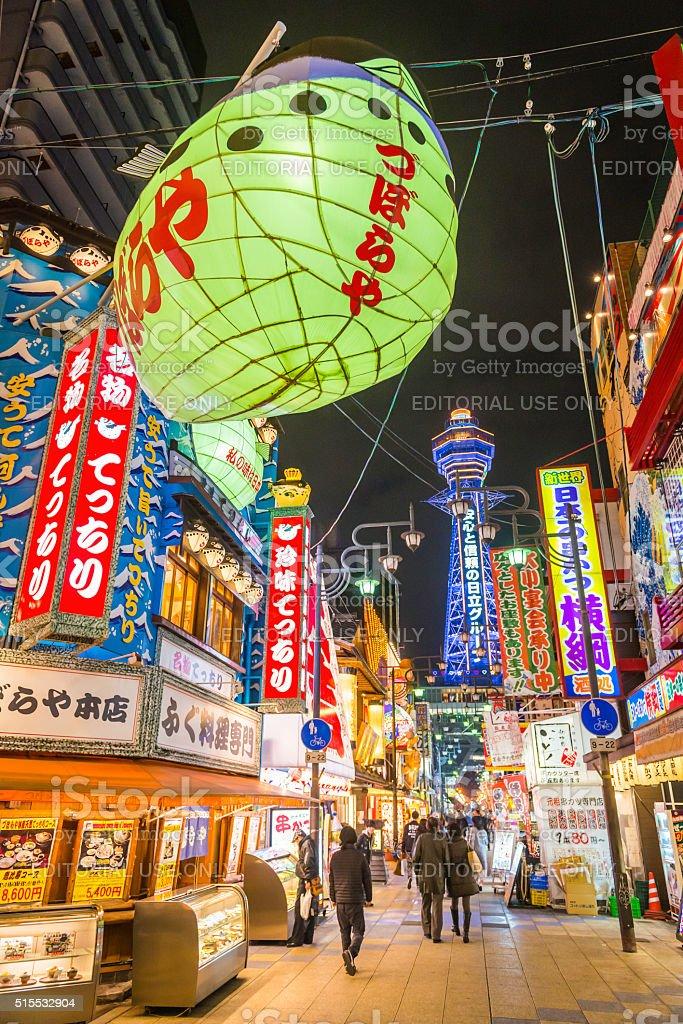 Japan colourful neon lights busy nightlife Shinsekai Tsutenkaku Tower Osaka stock photo