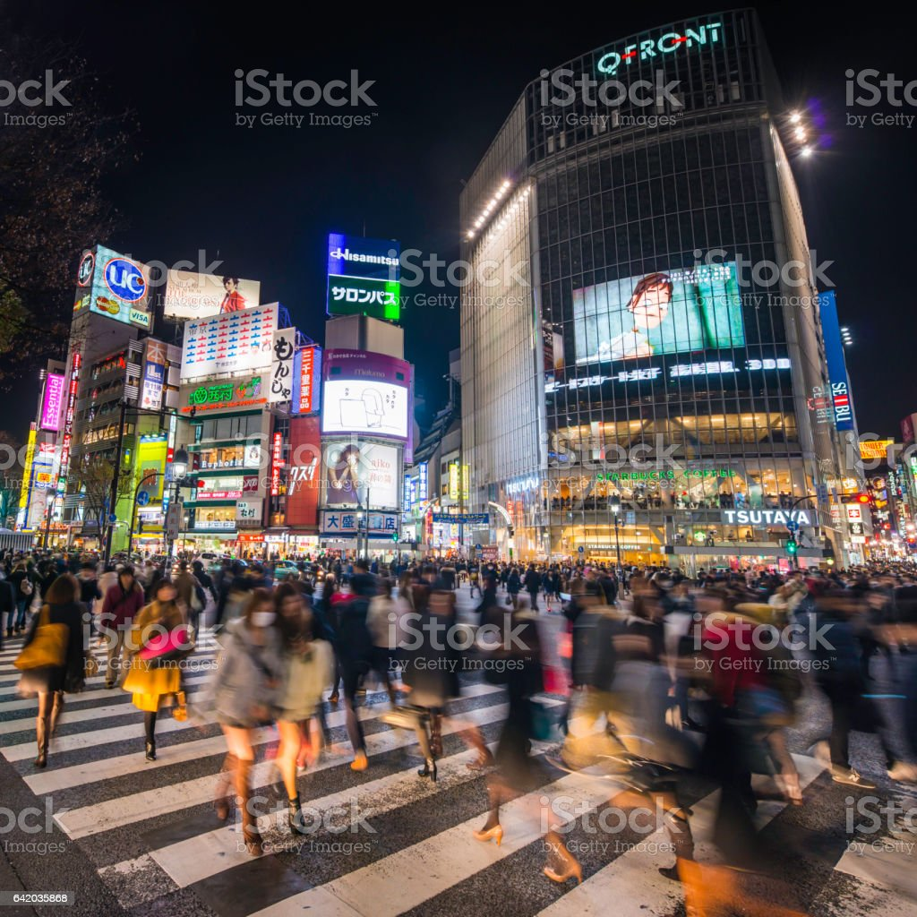 Japan crowds people Shibuya Crossing iconic neon night city Tokyo stock photo