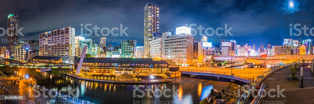 Japan illuminated night city highrises and restaurants Dotonbori canal Osaka stock photo