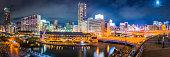 Japan illuminated night city highrises and restaurants Dotonbori canal Osaka