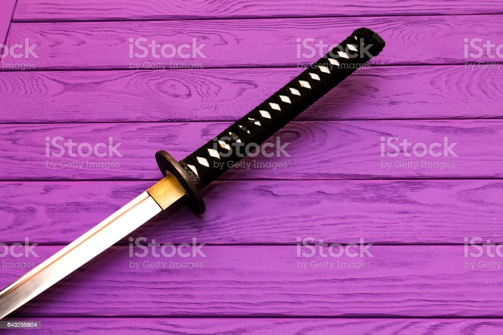 japan katana sword on the purple wood background stock photo