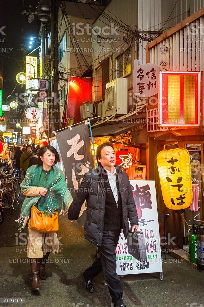 Japan locals in crowded Dotonbori bar district at night Osaka stock photo