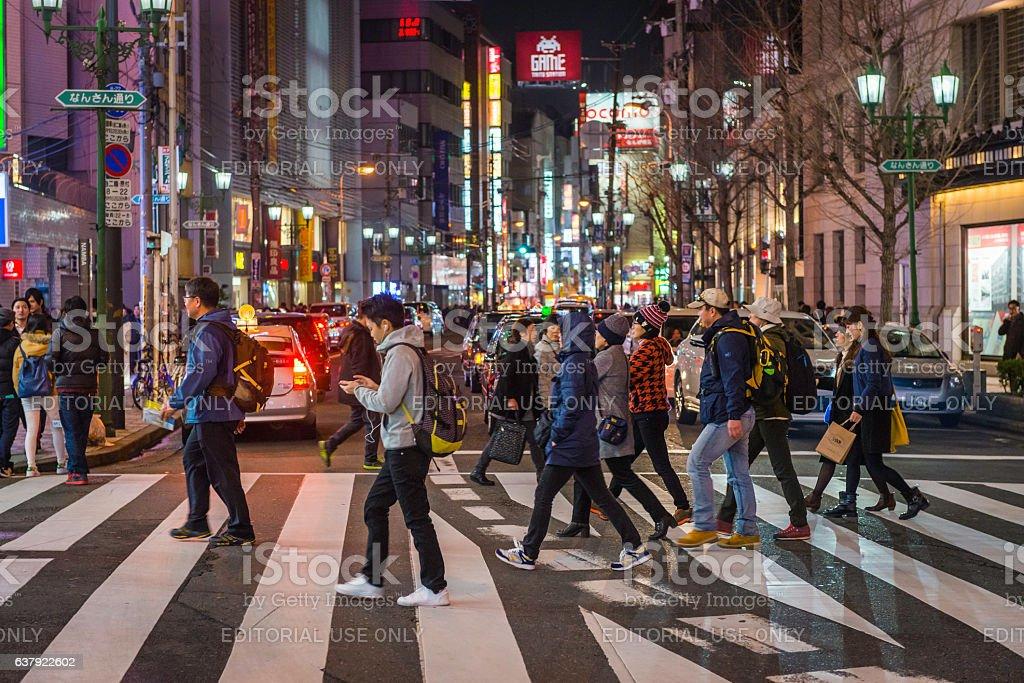 Japan people on pedestrian crossing crowded downtown streets Namba Osaka stock photo