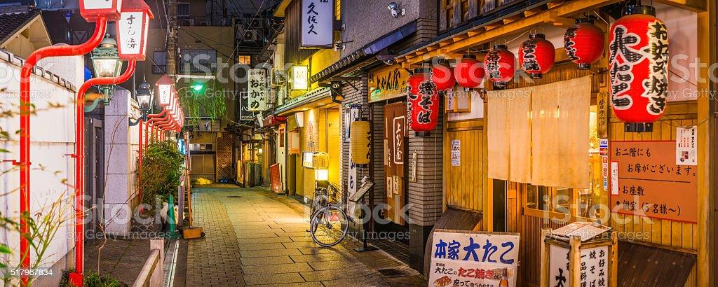 Japan quiet alleyway panorama restaurants bars illuminated at night Osaka stock photo