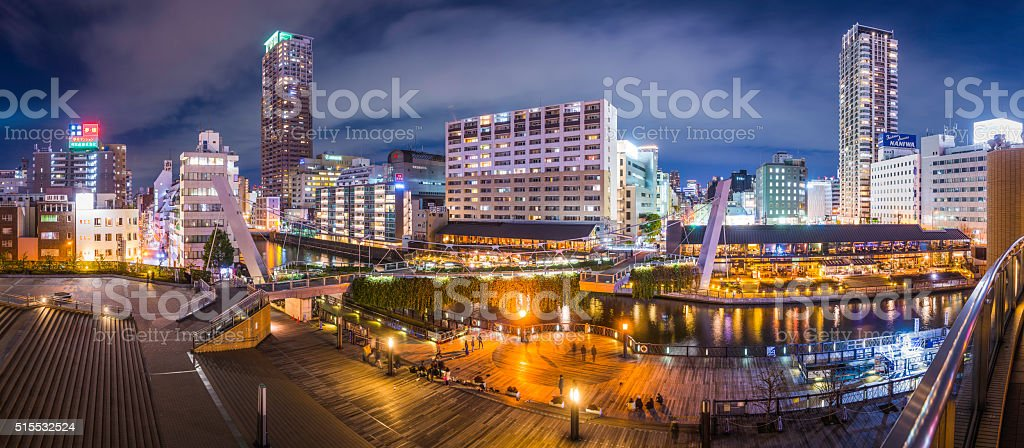 Japan skyscrapers and apartment buildings panorama illuminated at dusk Osaka stock photo