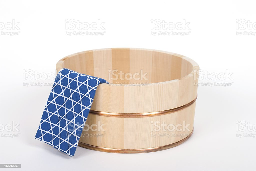 Japan towel and hot-water pot made ​​of wood stock photo
