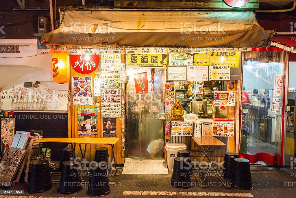 Japan traditional back street bar restaurant illuminated at night Osaka stock photo
