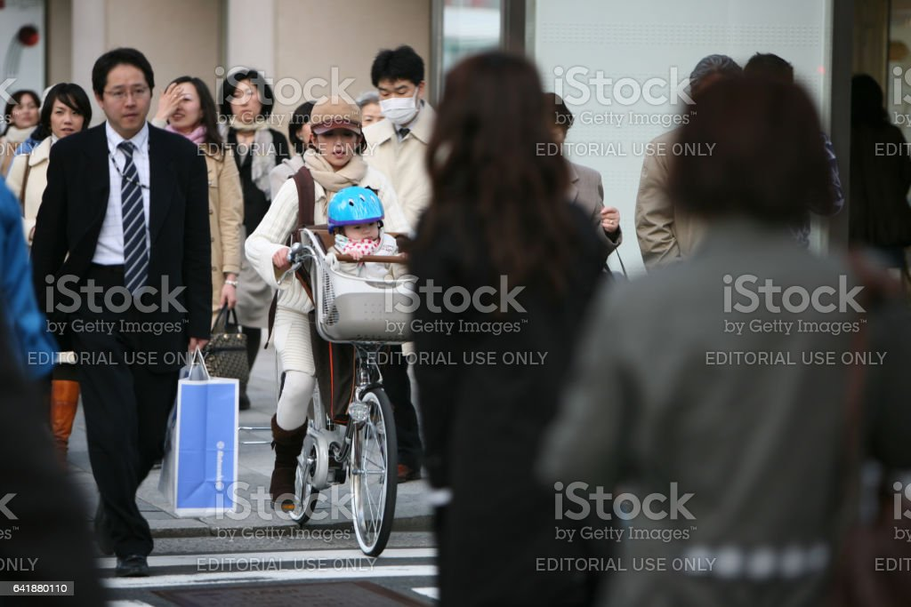 Japanese are crossing the street on a green traffic light stock photo
