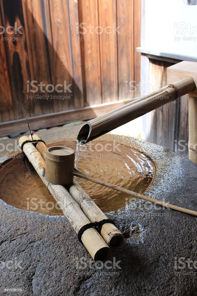 Japanese bamboo fountain and dipper stock photo