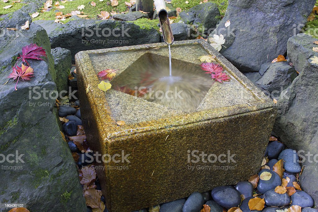 Japanese Bamboo Fountain with Stone Basin royalty-free stock photo
