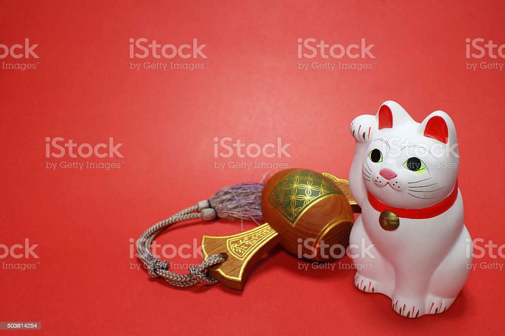 Japanese beckoning cat and lucky mallet in the red #4 stock photo