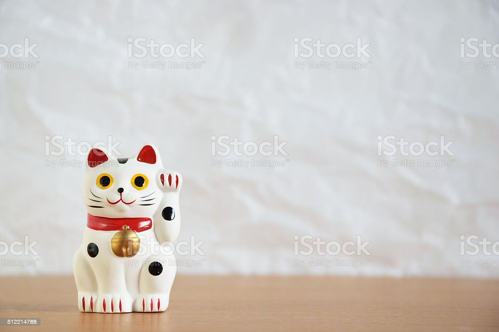 Japanese beckoning cat doll (maneki-neko) stock photo